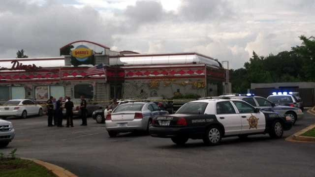 Investigators mill about the scene of a shooting a restaurant in Spartanburg County. (May 29, 2012/FOX Carolina)
