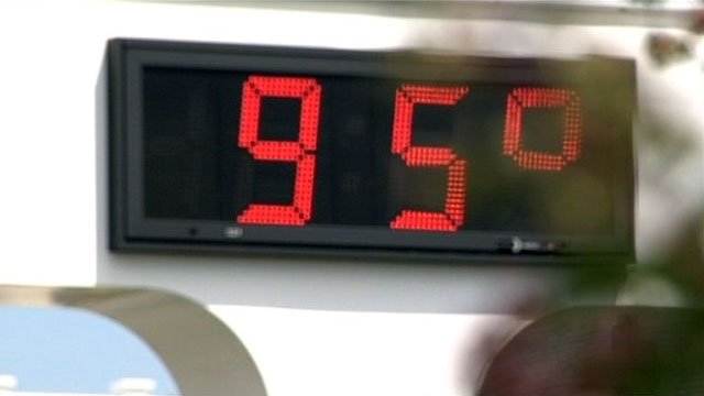 A thermometer at a Greenville bank displays the temperature on a summer day. (File/FOX Carolina)