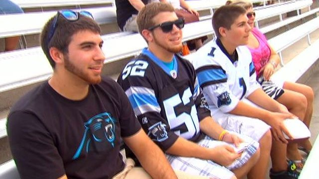 A group of Carolina Panther fans look on as player practice at Wofford College. (July 28, 2012/FOX Carolina)