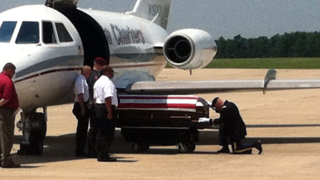 The plane carrying the body of Pfc. Adam Ross lands at GSP International Airport. (Aug. 2, 2012/FOX Carolina)