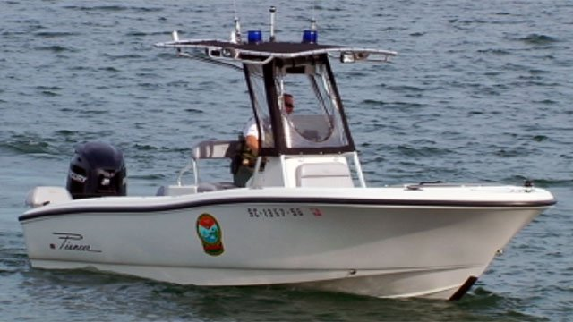 Officials search on the water for the missing man. (Aug. 5, 2012/FOX Carolina)