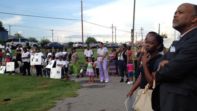 "Family and friends listen as others talk about Raheem ""Bobby"" Robinson at a vigil. (Aug. 8, 2012/FOX Carolina)"