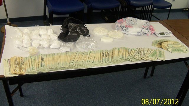 The cash and drugs seized at the Iris Lane home on Monday. (Cherokee Co. Sheriff's Office)
