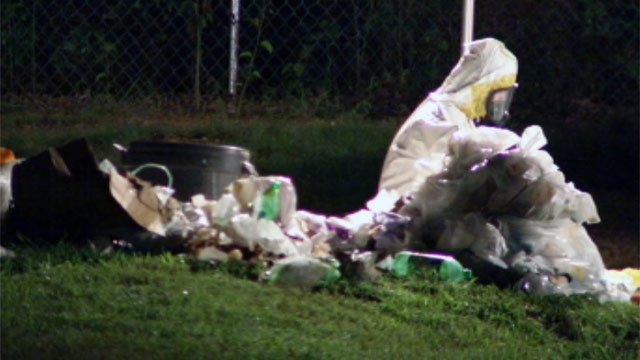 Clean-up crews go through the remains of a meth lab at a Greenville County home. (Aug. 8, 2012/FOX Carolina)
