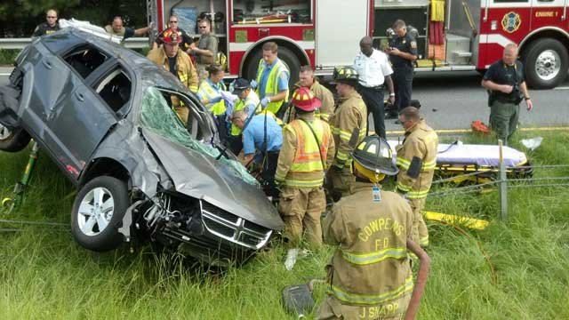 Rescuers work to a free a woman trapped in an SUV after a crash in Spartanburg County. (Aug. 6, 2012/Cowpens Fire Dept.)