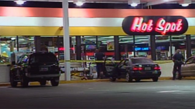 Deputies respond to a shooting after an armed robbery at the Hot Spot on Augusta Road. (Aug. 10, 2012/FOX Carolina)