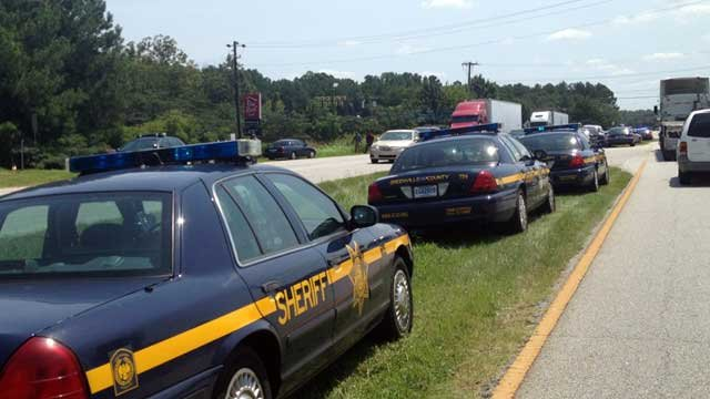 Deputies and police are parked along Laurens Road after a shooting at a nearby motel. (Aug. 13, 2012/FOX Carolina)