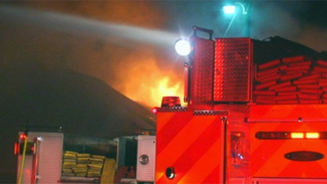 Flames burned through the roof of Williams Tire on Pendleton Road in Greenville. (Aug. 14, 2012/FOX Carolina)