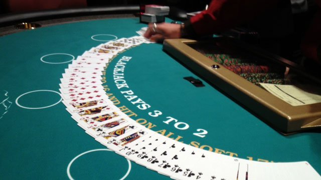 A dealer lays out a deck of cards on a gaming table at a casino in Cherokee, NC. (Aug. 15, 2012/FOX Carolina)