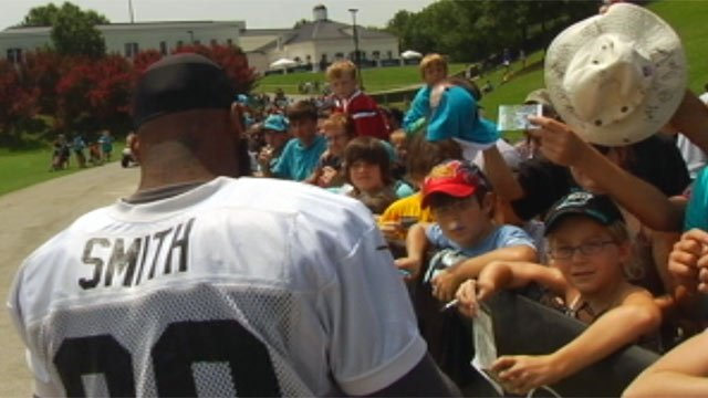 Carolina Panthers players sign autographs for fans at the last day of training camp. (Aug. 15, 2012/FOX Carolina)