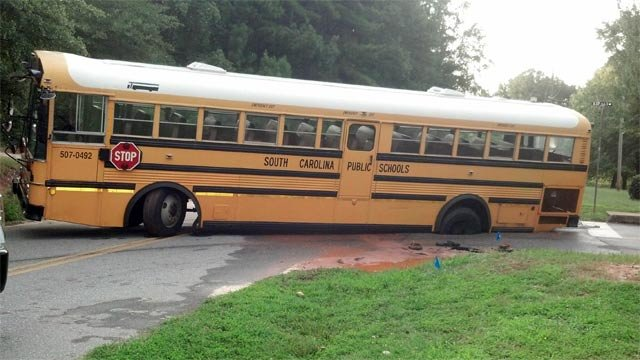 The school bus stuck in the small sink hole along S. Depot Street. (Aug. 23, 2012/FOX Carolina iWitness)
