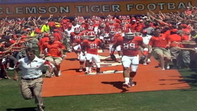 The Clemson Tigers run down the hill, a pre-game ritual that was ranked first. (File/FOX Carolina)