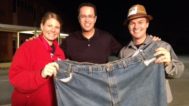 Summer and Joe Gagnon hold up Jared's old 60-inch jeans. (Aug. 29, 2012/FOX Carolina)