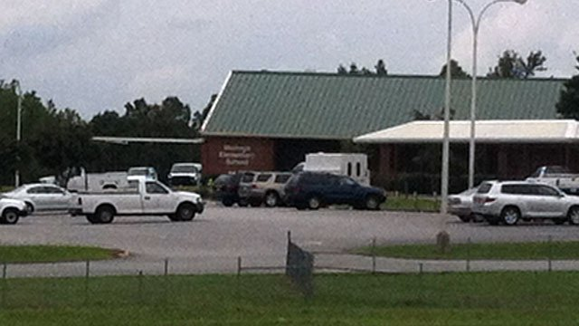 A fleet of maintenance vehicles are parked outside Heritage Elementary School. (Aug. 29, 2012/FOX Carolina)