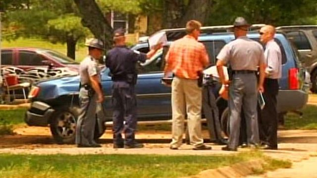Deputies and trooper investigate after a child was hit and killed by a car. (July 30, 2012/FOX Carolina)