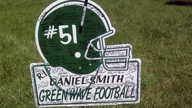 A football memorial is placed in Daniel Smith's yard. (Aug. 31, 2012/FOX Carolina)