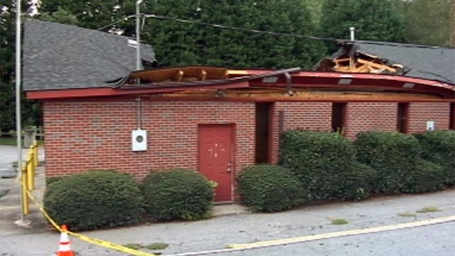 The collapsed roof of the River Falls fire department building. (Sept. 1, 2012/FOX Carolina)