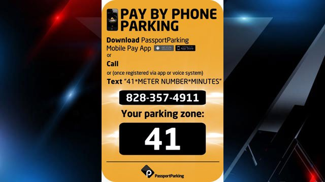 A sample instruction sticker on display for the pay-by-phone parking spaces. (City of Asheville)