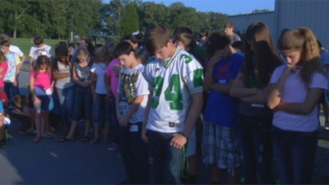 Students and friends pray together for the Daniel and Sandy Smith at Marathon Church. (Sept. 5, 2012/FOX Carolina)