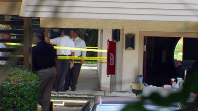 Deputies investigate the shooting at the Red Roof Inn. (Aug. 13, 2012/FOX Carolina)