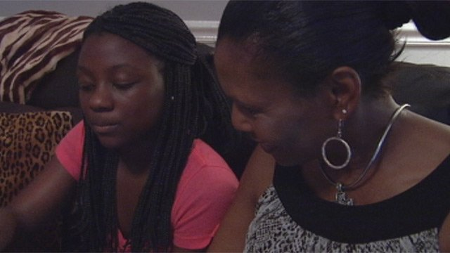 Cynthia Wright looks at family photos with her granddaughter Brylyn Hamlin. (Sept. 10, 2012/FOX Carolina)