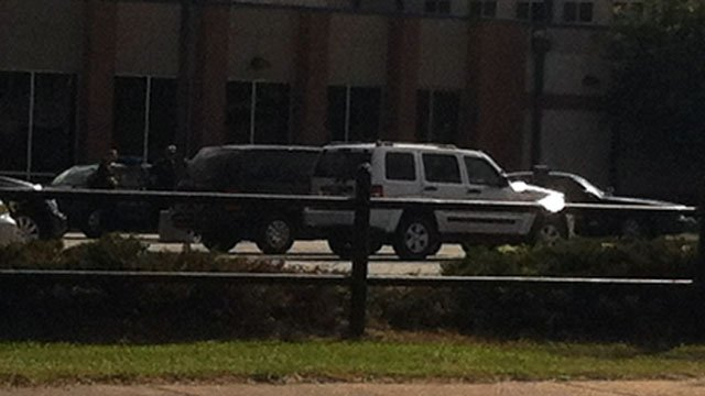 Deputies mill about the parking lot of Eastside High School after a fight. (Sept. 11, 2012/FOX Carolina)