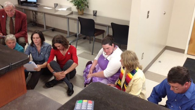 Protesters sit on the floor of the Buncombe County Register of Deed's office. (May 11, 2012/FOX Carolina)