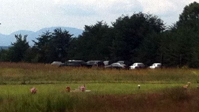 Investigators' vehicles are parked near the scene of where a body was found in Spartanburg County. (Sept. 14, 2012/FOX Carolina)