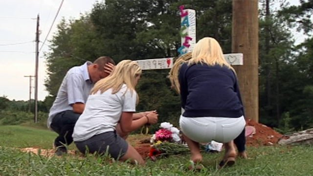Friends visit the memorial set up for Lacee Dial along Elrod Road. (Sept. 17, 2012/FOX Carolina)