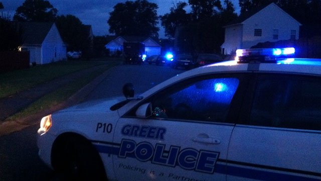 A Greer police cruiser blocks of a street where a standoff was happening. (Sept. 17, 2012/FOX Carolina)