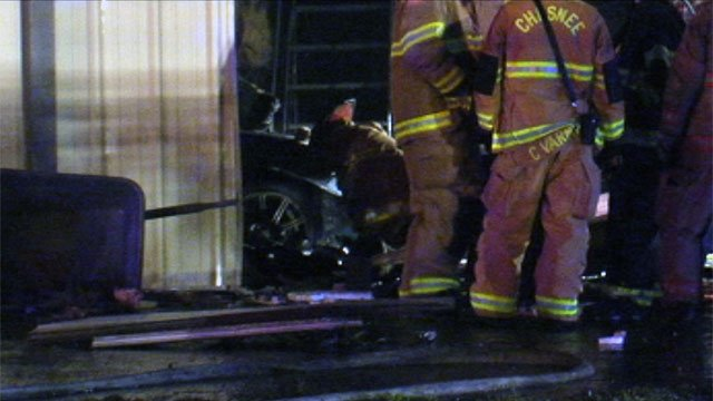 The car that plowed into the building and caught fire. (Sept. 17, 2012/FOX Carolina)