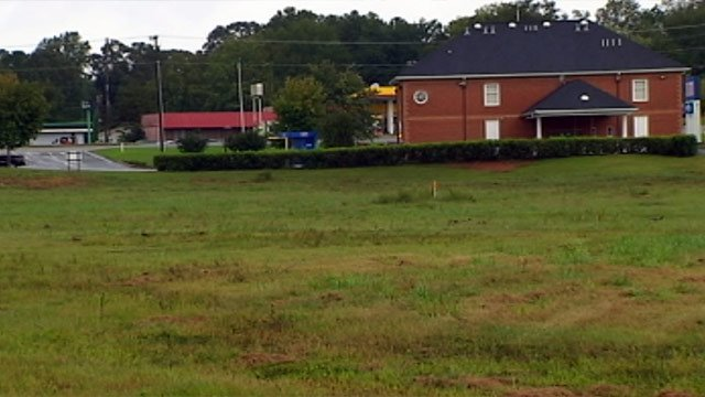 The land along E. North First Street where the Hampton Inn will be built. (Sept. 18, 2012/FOX Carolina)