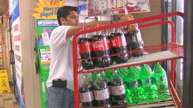 Jigar Patel restocks shelves placed where the sweepstakes machines had been located. (Sept. 18, 2012/FOX Carolina)