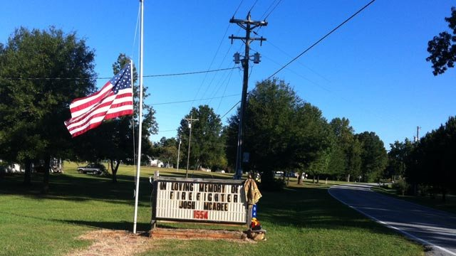 The American flag flies at half-staff after McAbee's death. (Sept. 24, 2012/FOX Carolina)