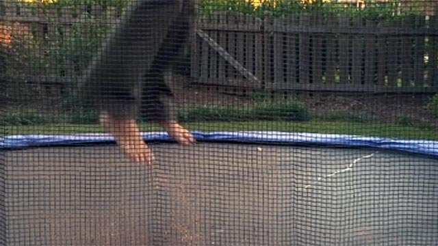FOX Carolina's Dana Wachter bounces on a Simpsonville family's trampoline. (Sept. 24, 2012/FOX Carolina)