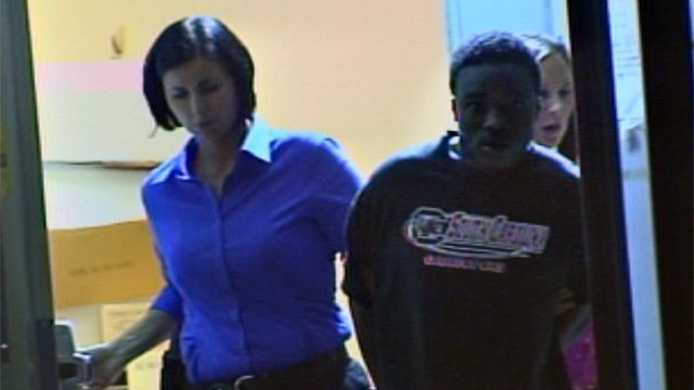 Deputies walk Rodney Davis Jr. out of the sheriff's office following his arrest. (Sept. 25, 2012/FOX Carolina)