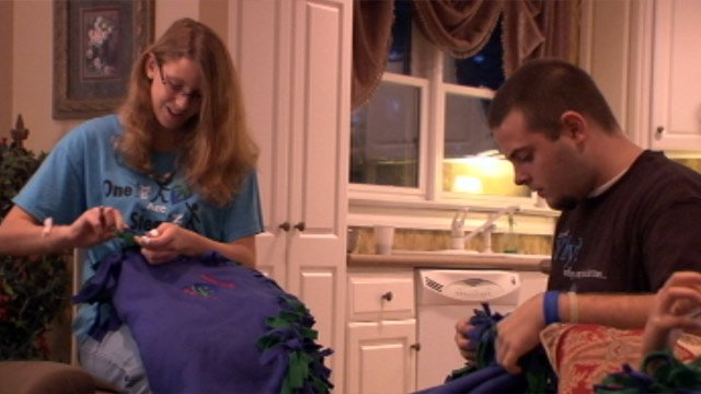 Volunteers make blankets that will be donated to the children. (Sept. 27, 2012/FOX Carolina)