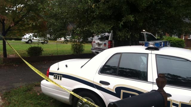 Crime scene tape surrounds one of the homes on Whitehall Road in Anderson. (Oct. 1, 2012/FOX Carolina)