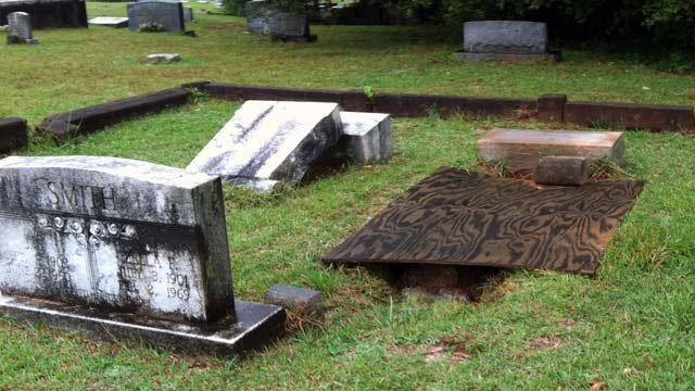 An exposed grave covered with plywood at Westview Cemetery in Easley. (Oct. 1, 2012/FOX Carolina)