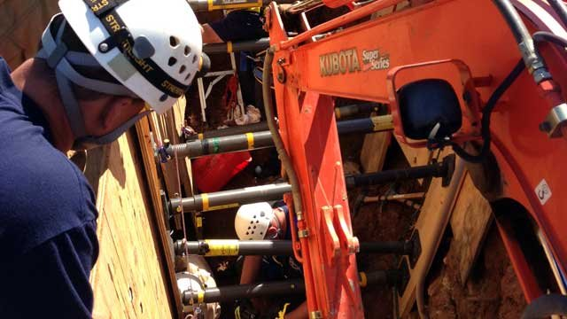 First responders work to free a man who was trapped in a trench in Asheville. (Oct. 4, 2012/Asheville Fire Dept.)