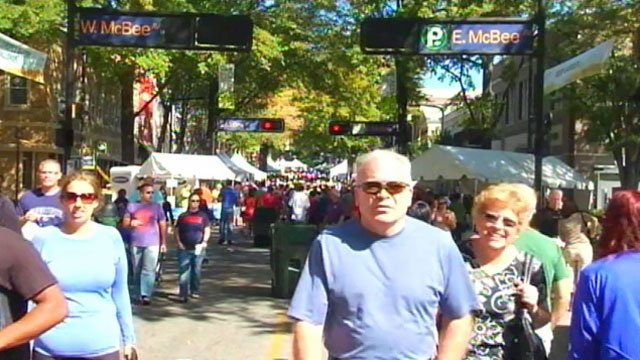 Thousands walk along Main Street in downtown Greenville during Fall For Greenville 2011. (File/FOX Carolina)