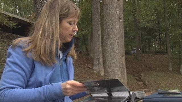 Meredith McGinnis looks through family photos at Paris Mountain Park. (Oct. 8, 2012/FOX Carolina)