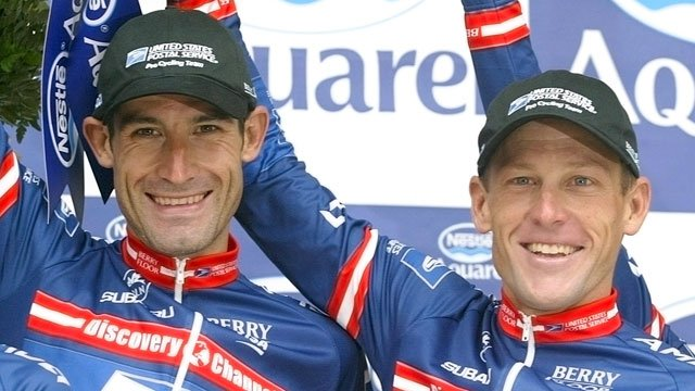 This July 7, 2004 file photo shows American cyclists George Hincapie, left, and Lance Armstrong on the podium after the 4th stage of the Tour de France race in Arras, France. (AP Photo/Laurent Rebours, File)