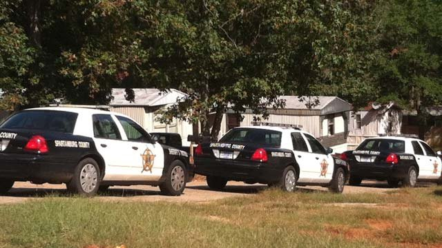 Deputies search a wooded area in Wellford off of Charter Oak Circle. (Oct. 10, 2012/FOX Carolina)