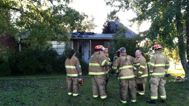 Firefighters at a home on Pelzer Highway that caught fire Thursday morning. (Oct. 11, 2012/FOX Carolina)