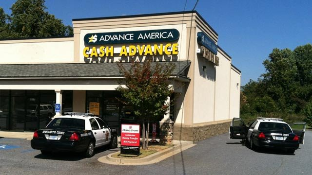 Deputy cruisers are parked outside an Advance America location after a robbery. (Oct. 17, 2012/FOX Carolina)