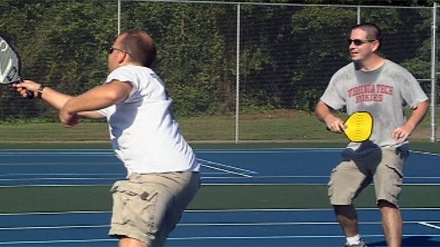 David Swick (left) and his teammate play Pickleball at Gower Park. (File/FOX Carolina)