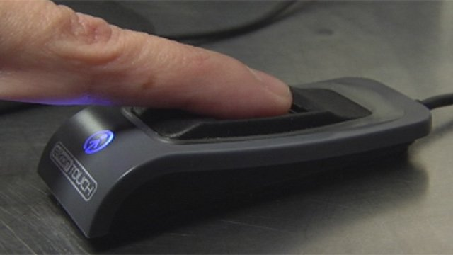 A finger is scanned through an Anderson District 5 school's new lunchroom system. (Oct. 18, 2012/FOX Carolina)