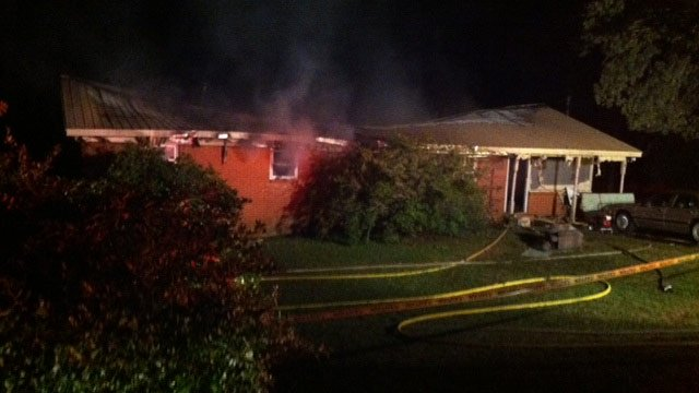 The Sunnyview Drive home destroyed by fire where two people were found dead inside. (Oct. 19, 2012/FOX Carolina)