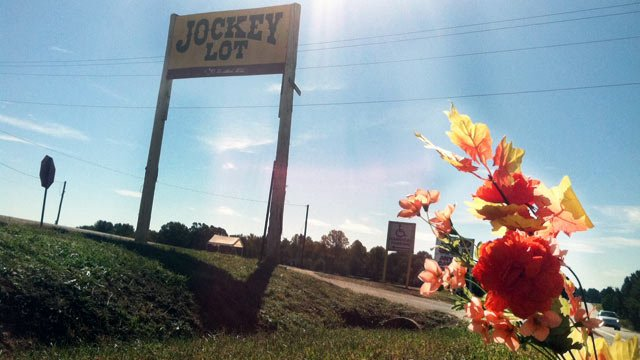 Flowers placed as a memorial outside of the Anderson Jockey Lot. (Oct. 22, 2012/FOX Carolina)